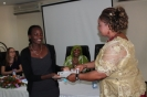 Creative Centre for Community Mobilisation (CRECCOM) GEWE Program Officer receiving the GEWE IP awards from Hon Minister Patricia Kaliyati